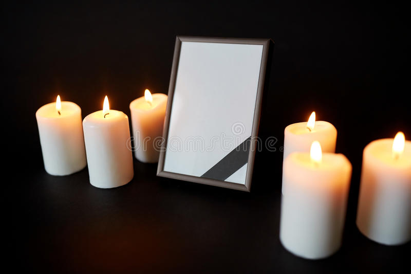 Unique Black Ribbon On Photo Frame And Candles At Funeral Stock Photo  ZH59