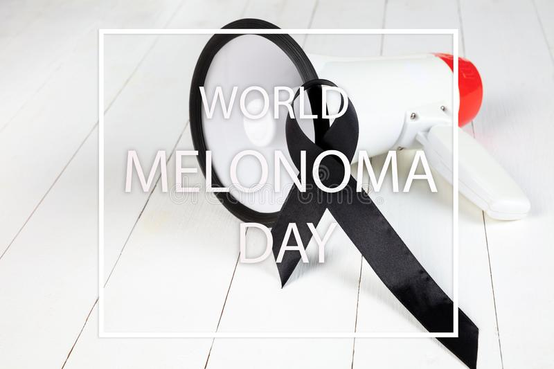 Black ribbon-symbol of fight against melanoma and skin cancer. royalty free stock image