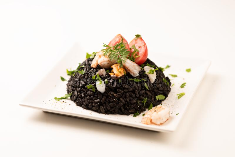 Black rice with cuttlefish on white royalty free stock photos