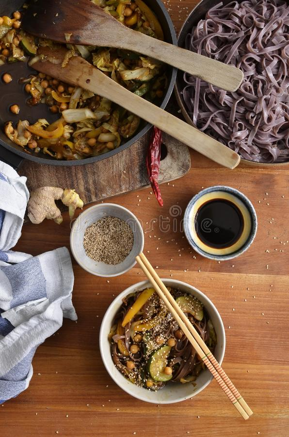 Black rice noodles with stir fried vegetables, soy sauce,dried c royalty free stock photos