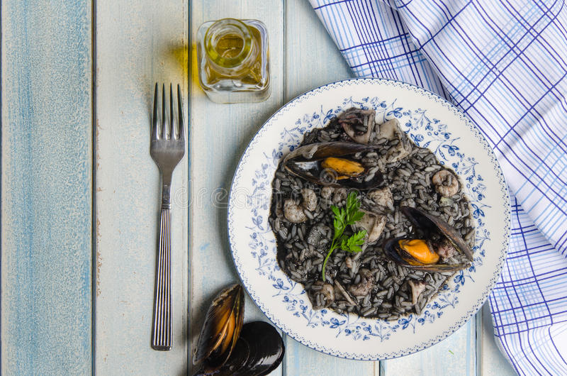 Black risotto plate with seafood. royalty free stock photo