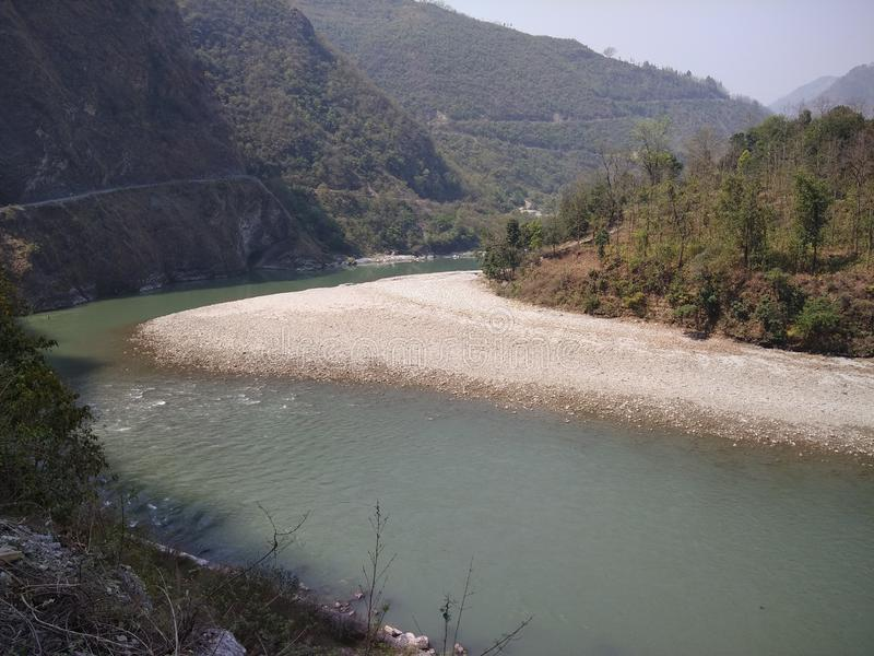 Black river divide two nation border. A black river dived two nation in hills area of india and nepal stock images