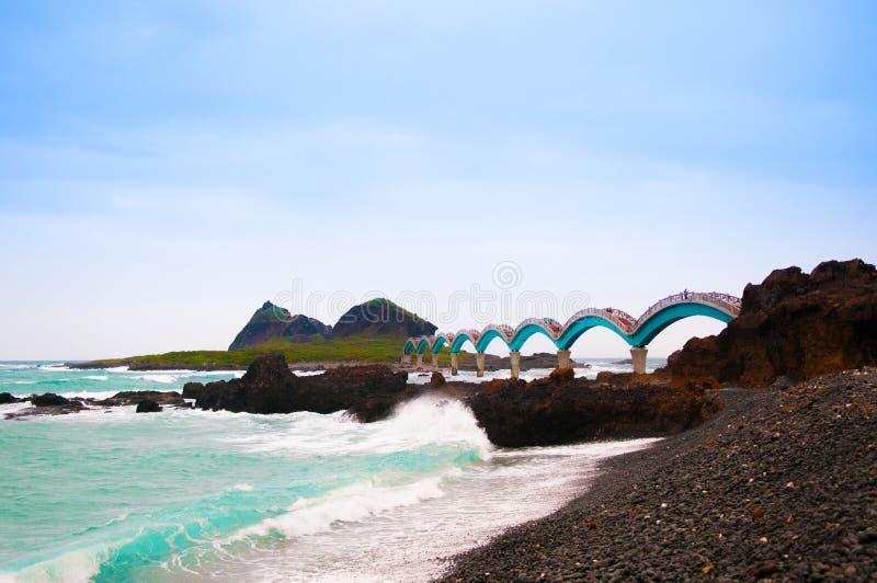 Black rocks beach and Sanxiantai bridge, Taitung, Taiwan. stock photography