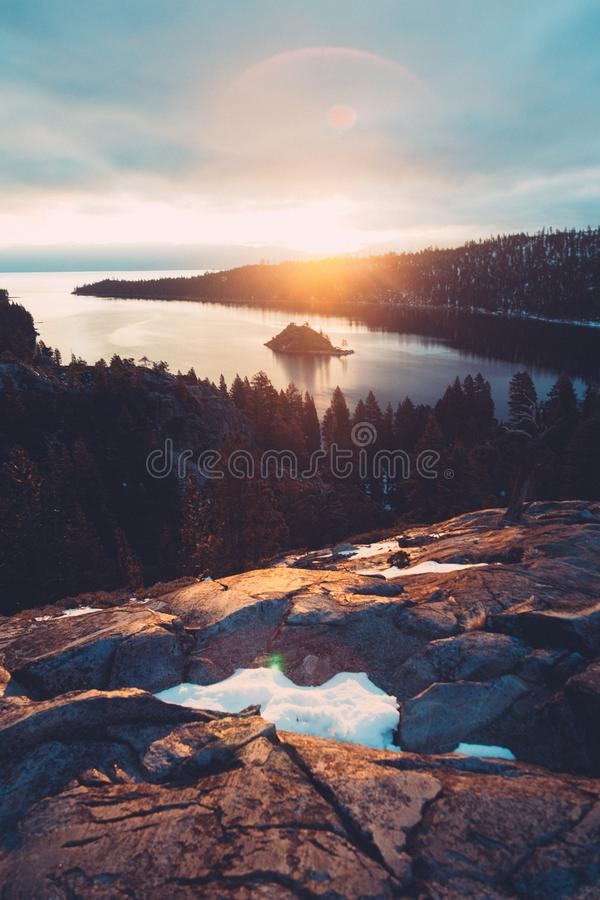 Black Rocks Over Green Trees Near Body Of Water During Sunrise Free Public Domain Cc0 Image