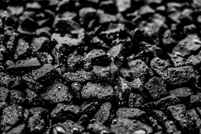 Black rocks with spots of water stock photos