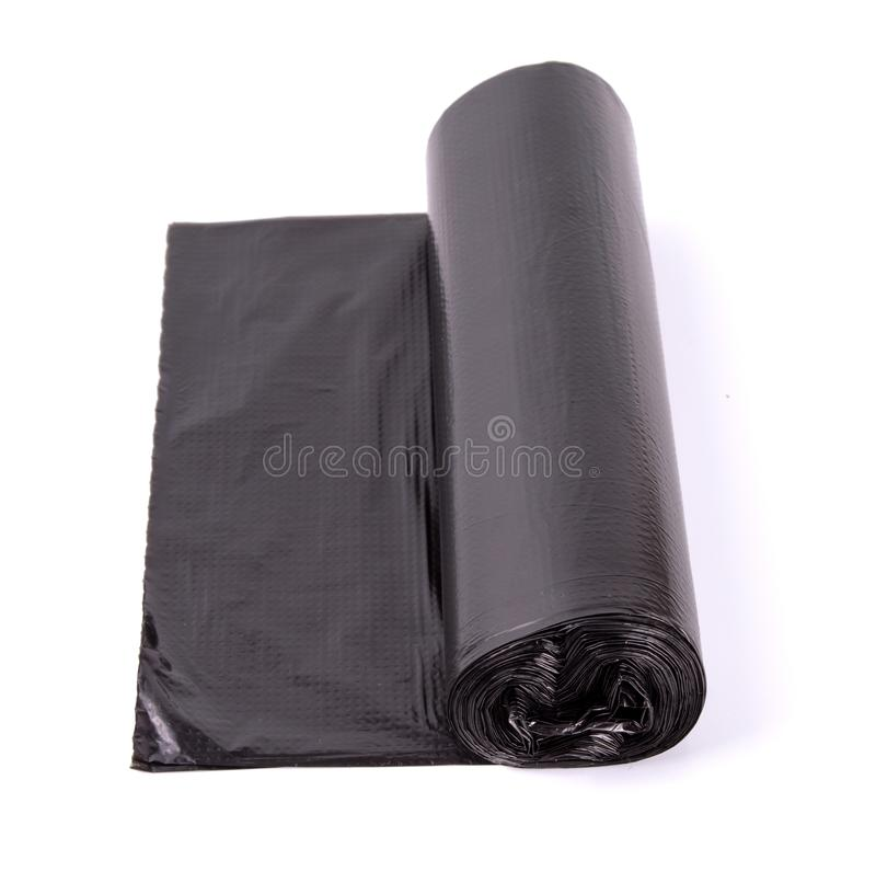 Black roll of plastic garbage bags isolated on white background royalty free stock photography