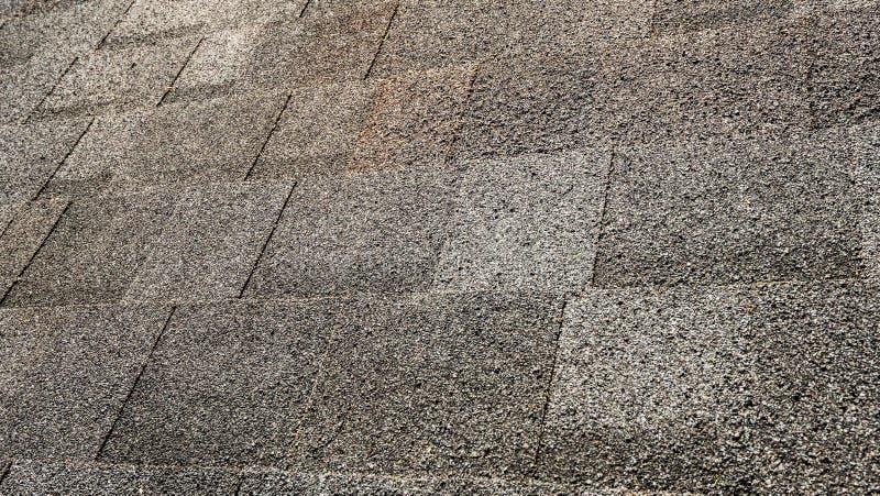 Black Roof Shingles. Layer of black graphite bitumen roof tiles stock image