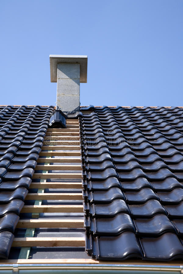 Black roofing tiles. Roof with black roofing tiles royalty free stock photos