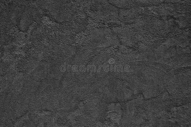 Black rough concrete wall - fine textured surface with small cracks royalty free stock photos