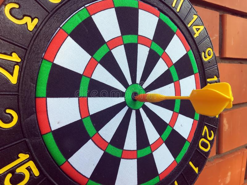 Black round darts with an arrow. royalty free stock image