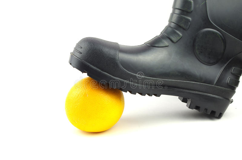 Black rubber boots with orange royalty free stock image