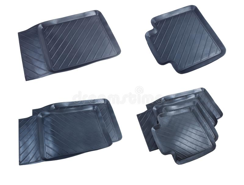 Black rubber car mats isolated on a white background. stock images
