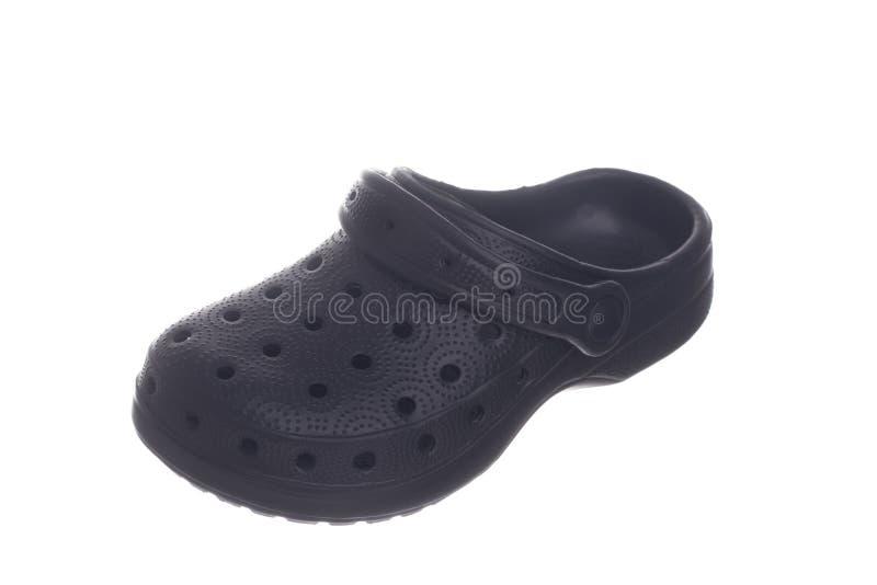 Black rubber shoe. Isolated on white background royalty free stock photos
