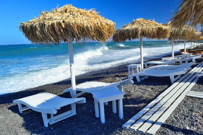 Black sand beach at Kamari, Santorini stock photography