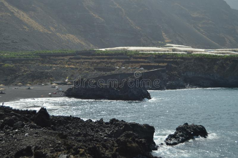 Black Sand Beach With A Large Stone In Its Interior In Puerto Naos In The City Of Los Llanos. Travel, Nature, Landscapes.11 July royalty free stock photography