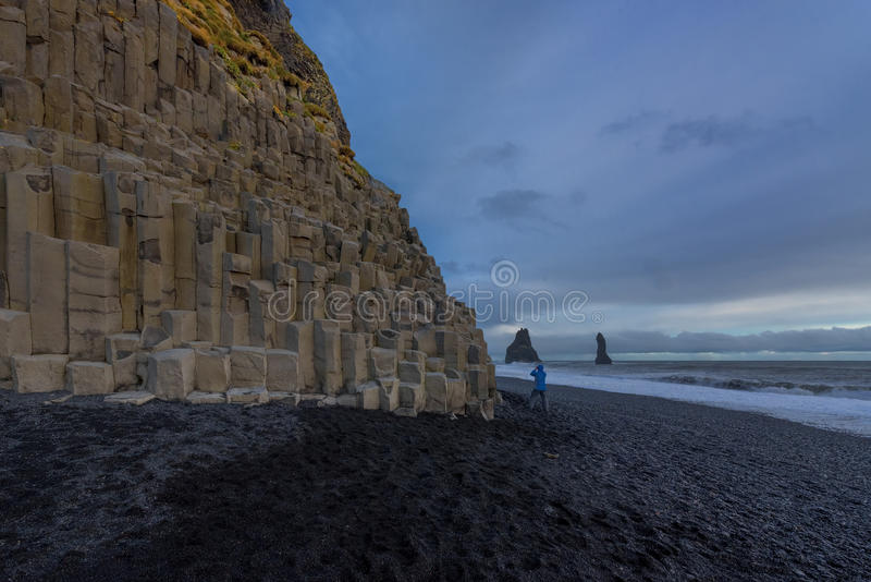 The black sand beach of Reynisfjara. And the mount Reynisfjall from the Dyrholaey promontory in the southern coast of Iceland stock image