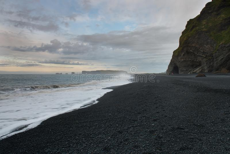 The black sand beach of Reynisfjara to the Dyrholaey. Promontory in the southern coast of Iceland stock images