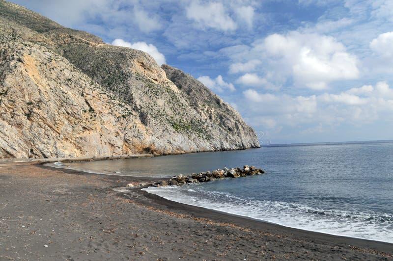 Black Sand Beach Santorini royalty free stock photography
