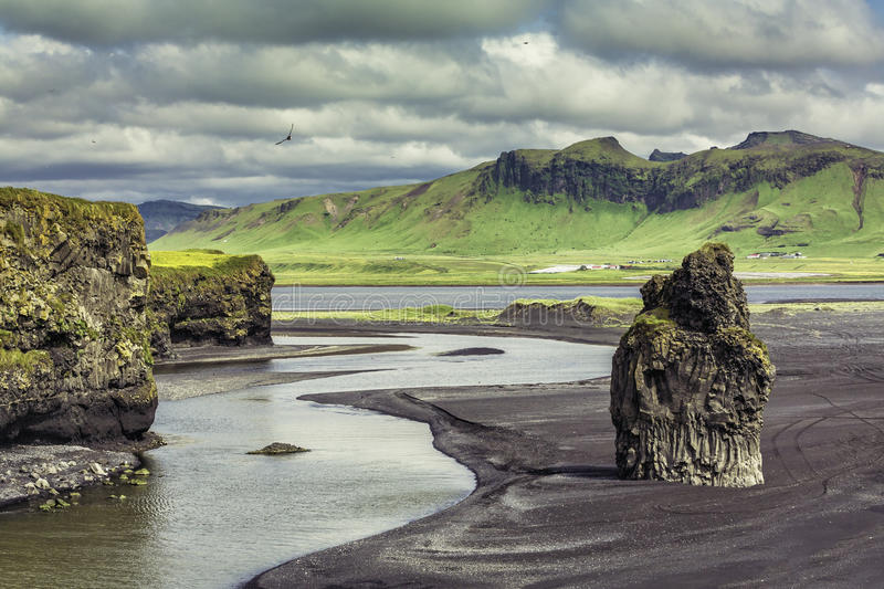 The black sand beach with typical Icelandic mountain royalty free stock photos