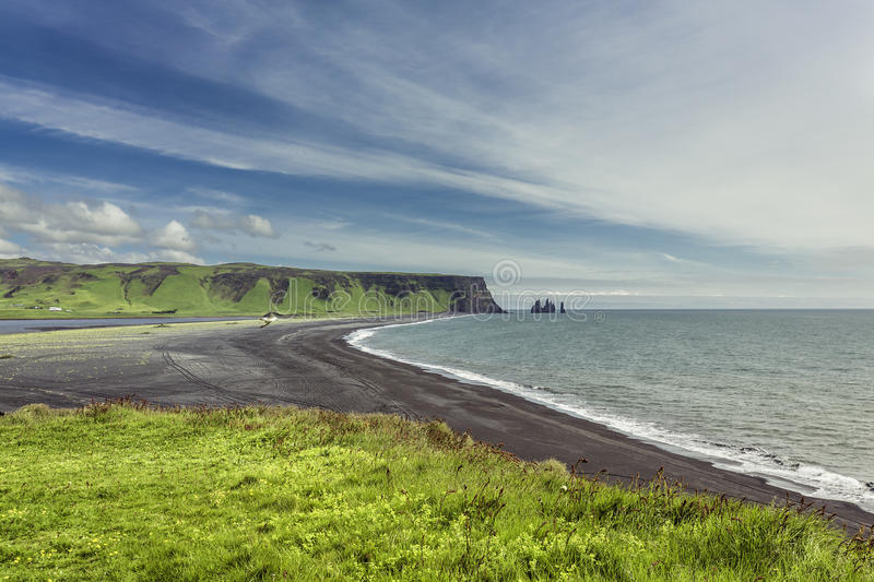 The black sand beach with typical Icelandic mountain royalty free stock image