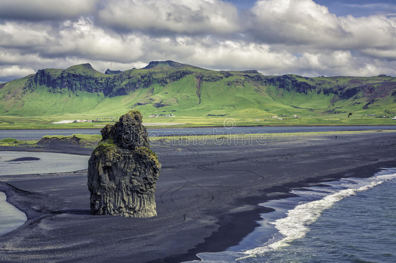 The black sand beach with typical Icelandic mountain royalty free stock photo