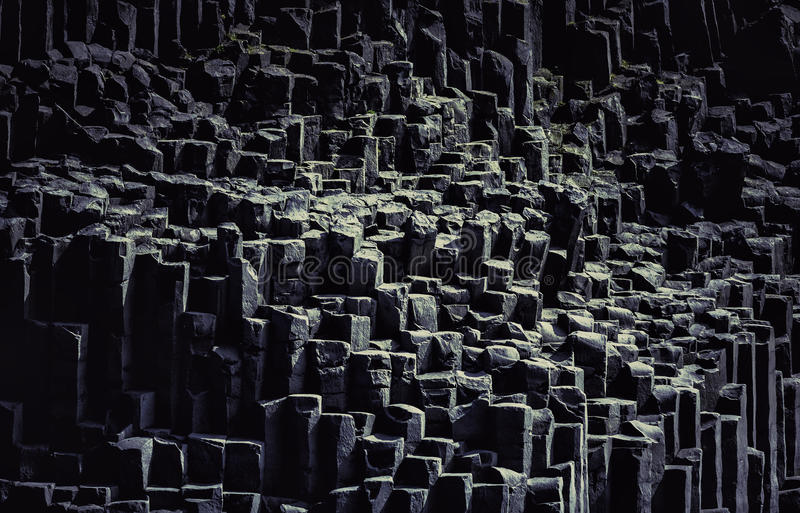 The black sand beach with typical rock formation. In Iceland stock photography
