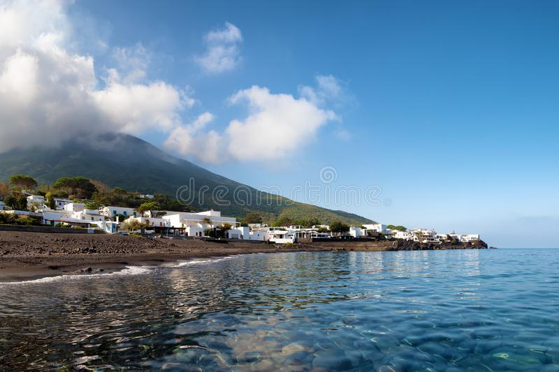Black sand and clear water of the `ficogrande` beach near the stromboli volcano. Aeolian islands, italy stock photos
