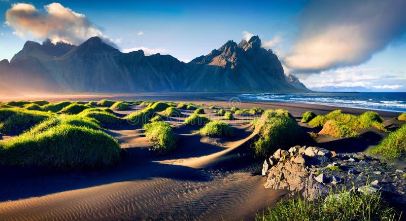 Black sand dunes on the Stokksnes headland on southeastern Icelandic coast. With Vestrahorn Batman Mountain. Colorful summer morning Iceland, Europe. Artistic stock photo