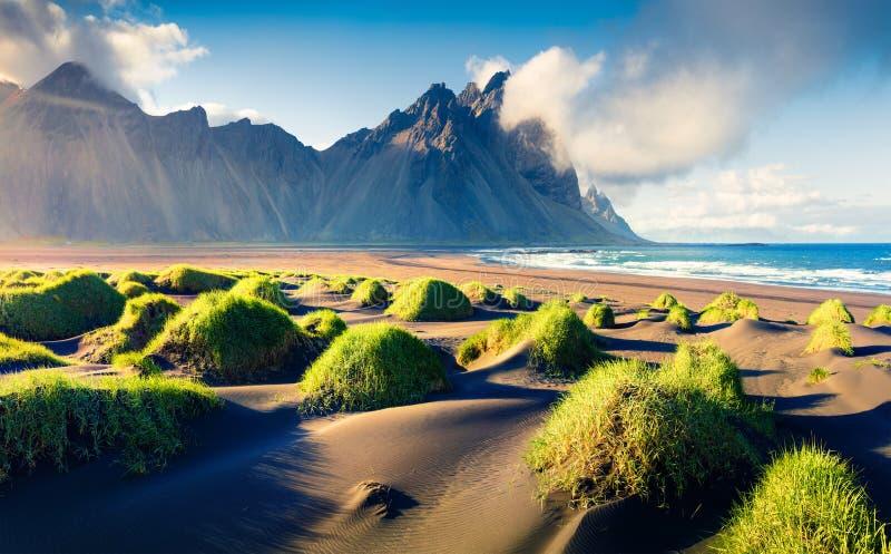 Black sand dunes on the Stokksnes headland on southeastern Icelandic coast with Vestrahorn (Batman Mountain). Black sand dunes on the Stokksnes headland on stock photography