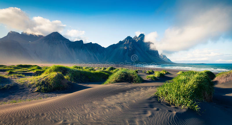 Black sand dunes on the Stokksnes headland. On southeastern Icelandic coast. Colorful evening landscape in the Iceland, Europe. Artistic style post processed stock photography