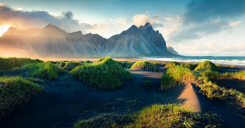 Black sand dunes on the Stokksnes headland. On southeastern Icelandic coast. Colorful evening landscape in the Iceland, Europe. Artistic style post processed stock images