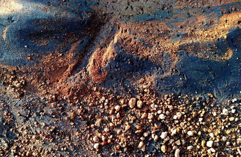 Black sand with small pebbles stock photos