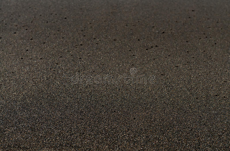 Black sand volcanic beach background