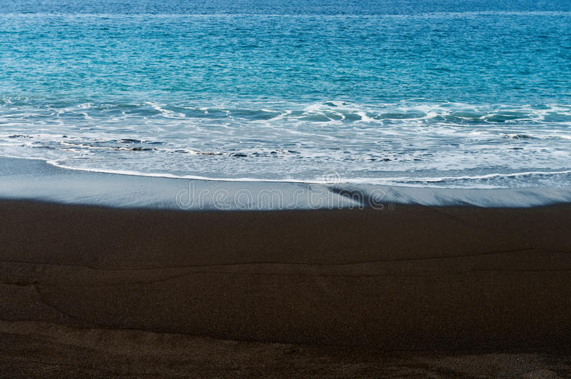 Black Sand Volcanic Beach With White Foam Sea Wave Stock Images