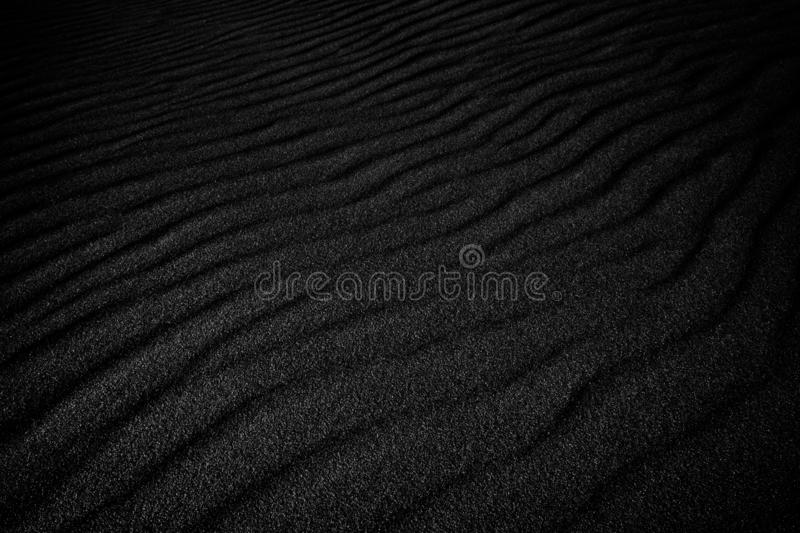 Black sand waves as background.  royalty free stock photography