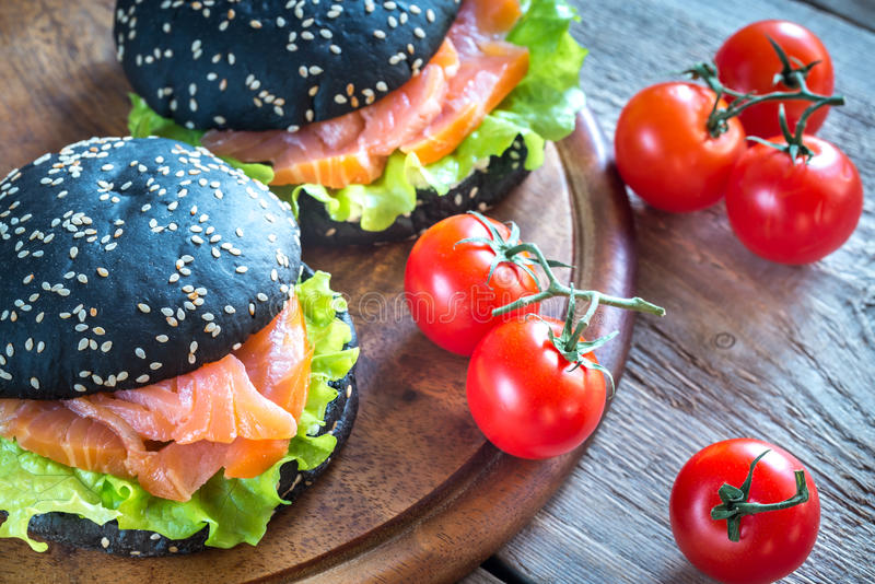 Black sandwich with salmon stock images