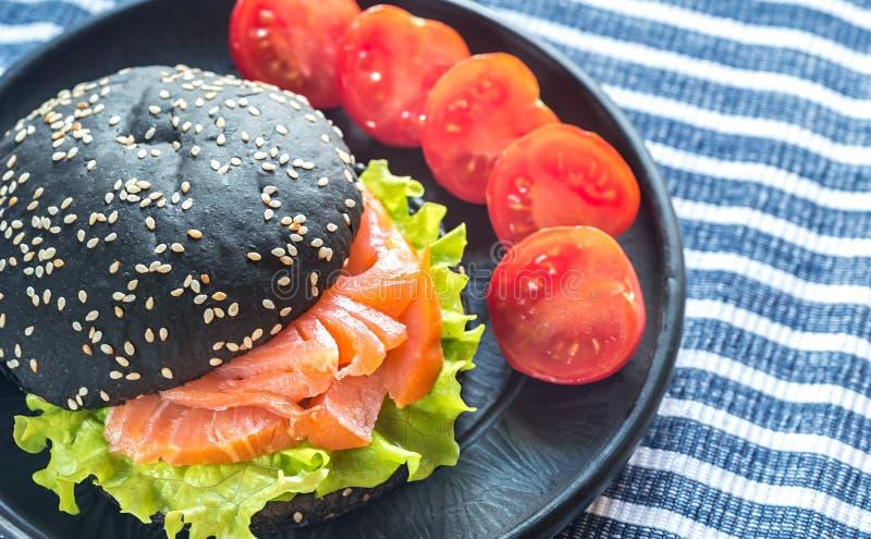 Black sandwich with salmon stock photo