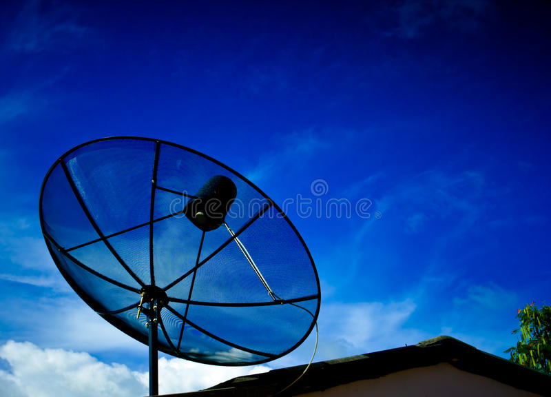 Black satellite dish with blue sky. The black satellite dish with blue sky stock image