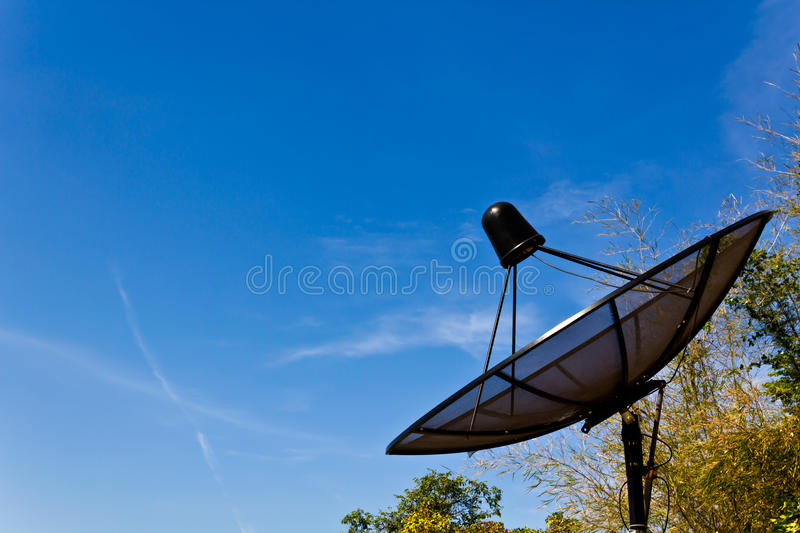 Black Satellite information signals. Are sent to space royalty free stock photography