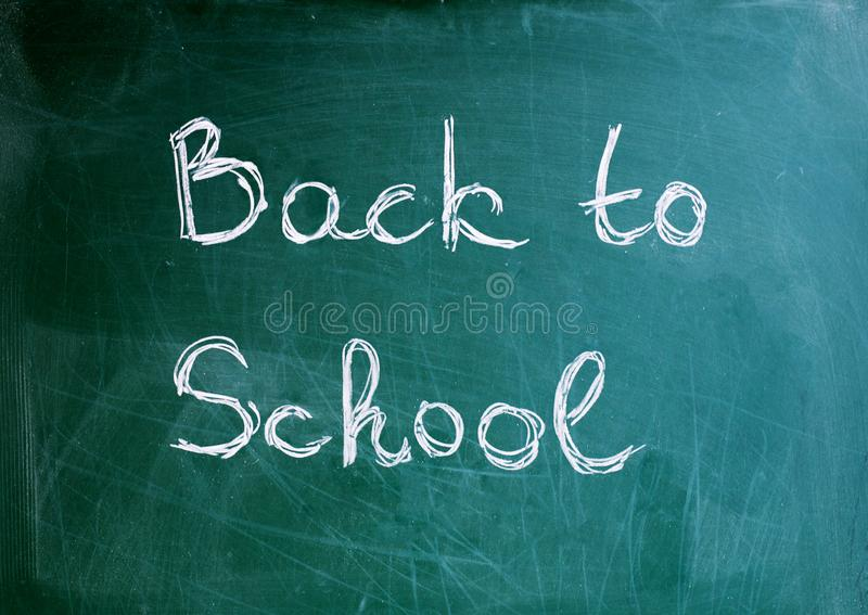 Black school chalkboard background with the inscription back to school stock photo