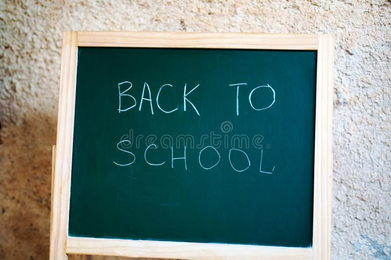 Black school chalkboard on wall background stock image