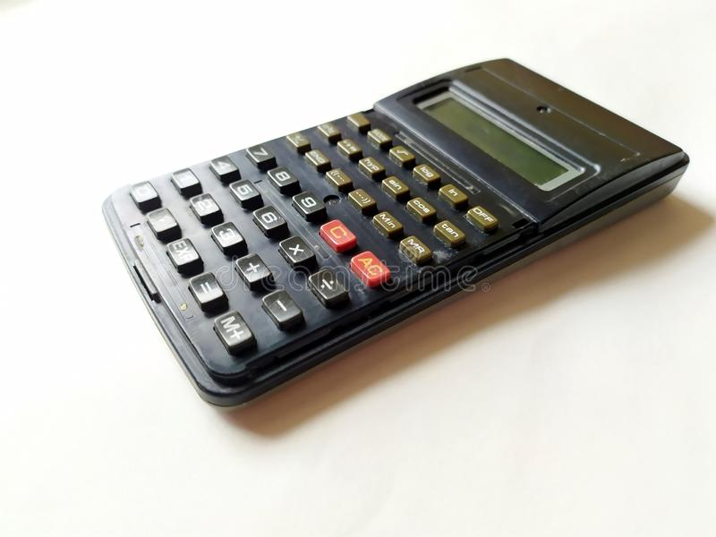 Black scientific calculator isolated on white background royalty free stock photography