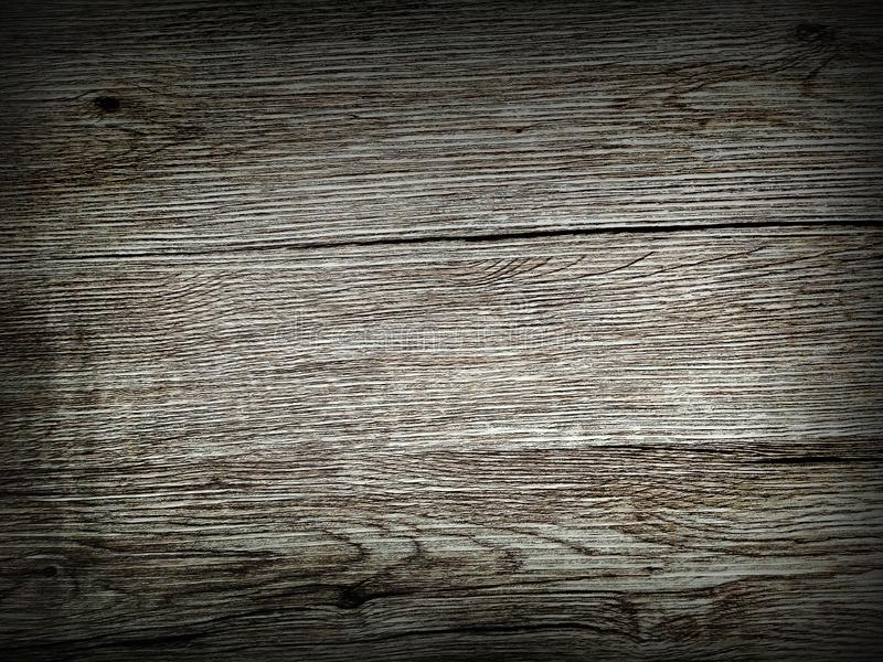 Black scratched wooden board. Wood background texture of board surface. A simple wallpaper to use in commercials.  stock images