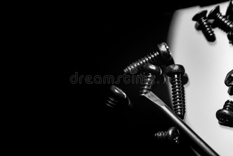 Black screws on a dark background royalty free stock photos
