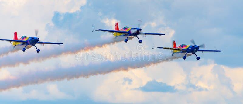 Black sea air show. Stunt, plane, airplane, tricks, smoke, formation, propeller, movement, trail, sky, nikon, d610, tamron, 70-300, constanta stock photo