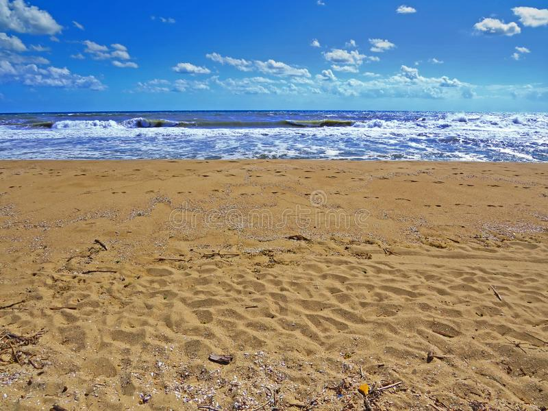 Black sea sands and stormy waves. Summer vacation. Black sea sands and stormy waves. Summer vacation and fun royalty free stock photography