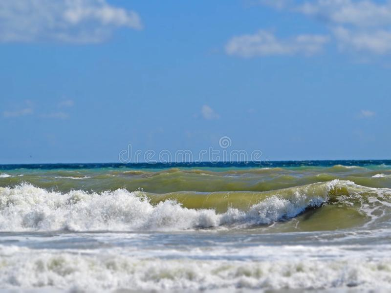 Black sea sands and stormy waves. Summer vacation. Black sea sands and stormy waves. Summer vacation and fun royalty free stock images