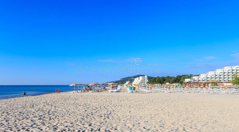 The Black Sea shore, blue clear water, beach with sand, Albena, Bulgaria. The Black Sea shore, blue clear water, beach with sand, umbrellas and sunbeds. Morning stock photos