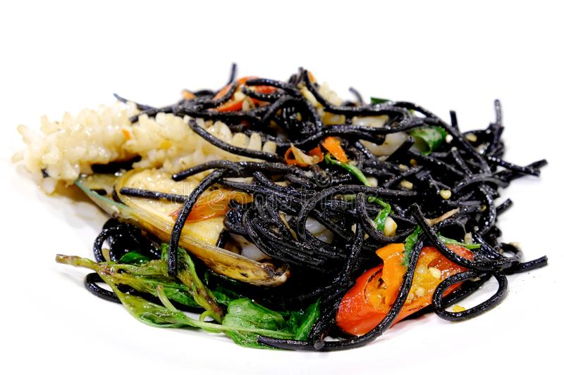 Black seafood spaghetti menu with squid, chilli, mussel and vegetables. Italian black seafood spaghetti menu with squid, chilli, mussel and vegetables royalty free stock photo
