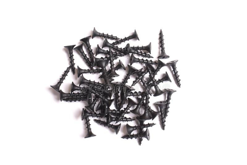Black self-tapping screws isolated on white background royalty free stock photos